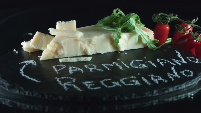 4K Close-up Cheese Parmigiano-Reggiano with Cherry Tomatoes video