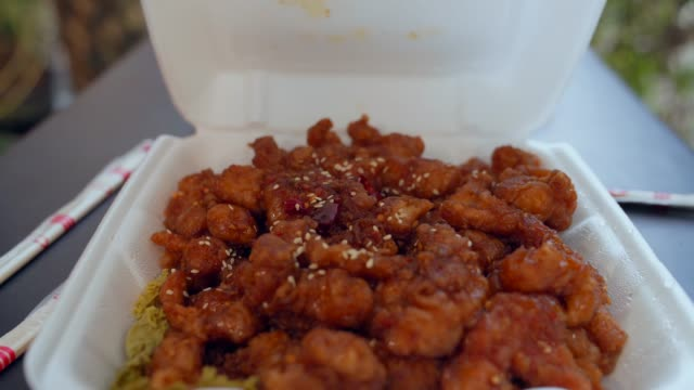 closeup chinese takeout sweet and sour orange chicken reveal video