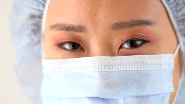 Closeup Chinese woman doctor video