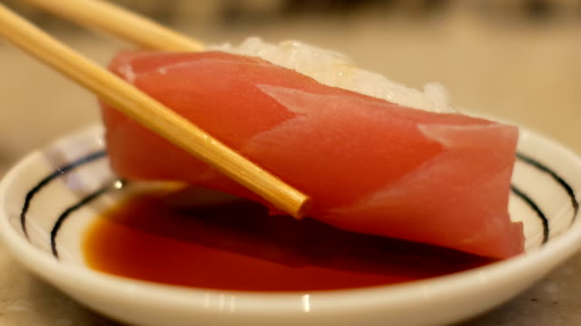 Close-up chopstick with sushi Close-up chopstick with sushi (Japanese food) sashimi stock videos & royalty-free footage