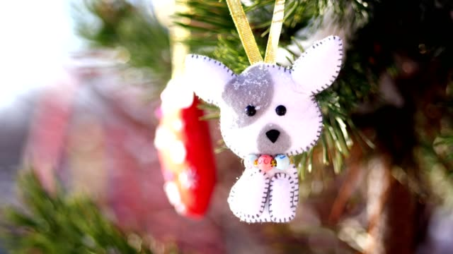 close-up, Christmas toys hanging on a snow-covered tree branch. winter, frosty, snowy, sunny day