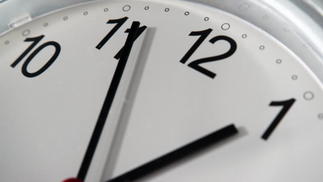 Closeup clock ticking showing one hour, timelapse 4K Nobody. Closeup white clock ticking showing one hour, time lapse 4K instrument of time stock videos & royalty-free footage