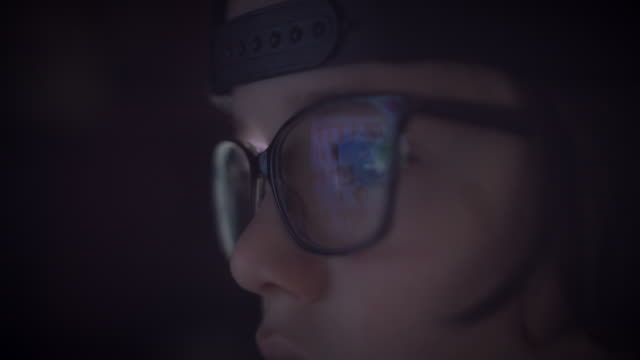 4K Close-up Computer Reflection in Glasses of a Child Eyes video