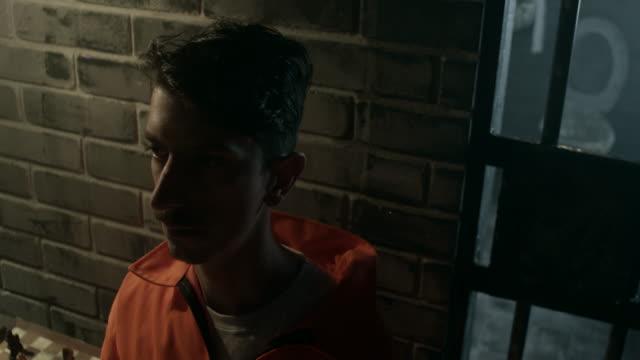 Close-up, convict on interrogation in prison video