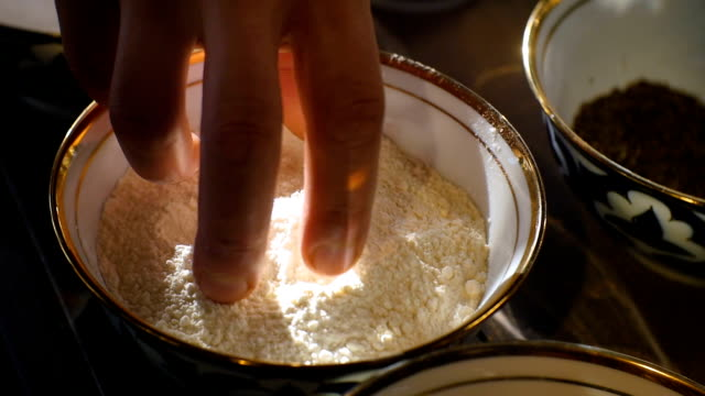 Closeup Cook Hand Touches Flour by Fingers in Bowl