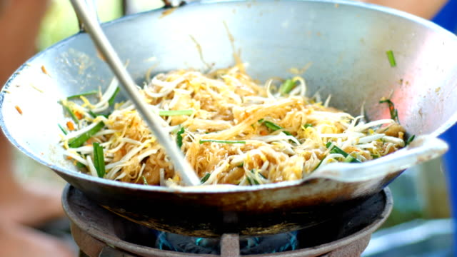 close-up cooking fried noodle, pad thai, famous street food - thai food stock videos and b-roll footage