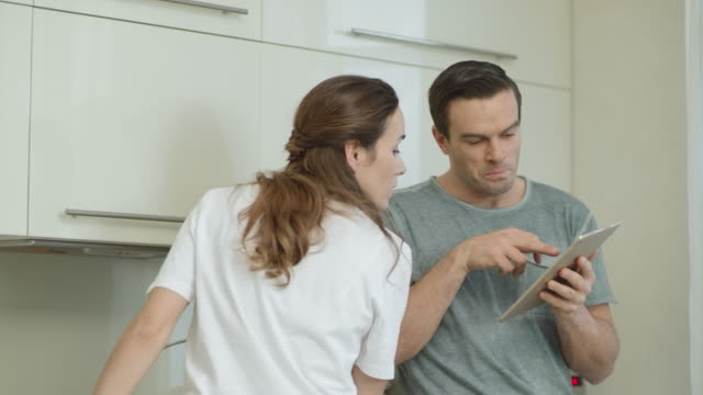 vídeos de stock e filmes b-roll de closeup couple choosing recipe for breakfast at home. - cooker happy