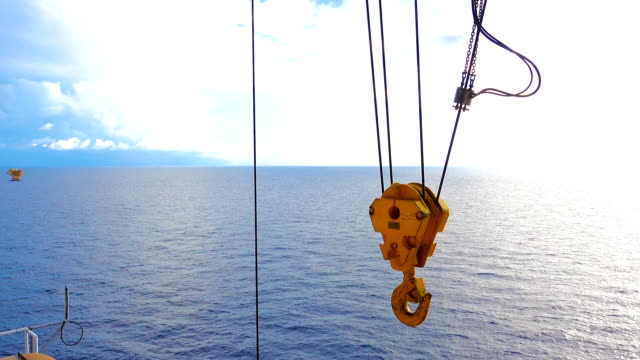 Closeup crane Hook on Heavy Shipping Port Crane on offshore platform while rise up video
