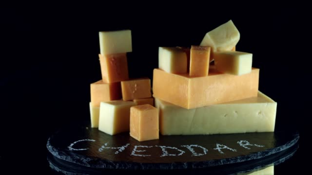 4K Close-up Cubes of White and Red Cheddar Cheese video