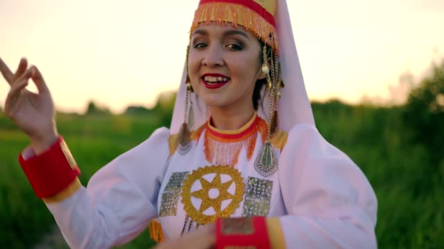 close-up. dance of young woman in traditional costume of mari people - costume tradizionale video stock e b–roll