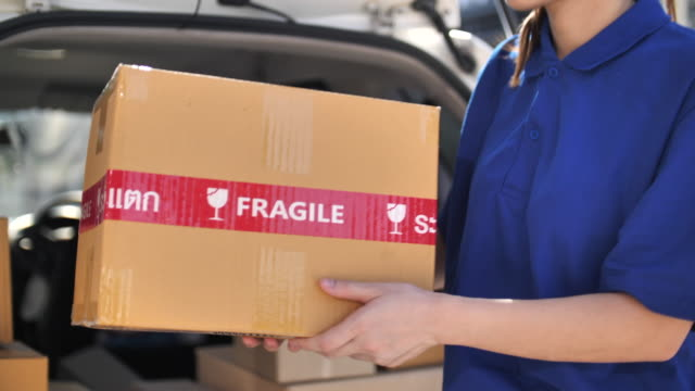 Close-up Delivery Person carrying Box for Delivery to Customer at home