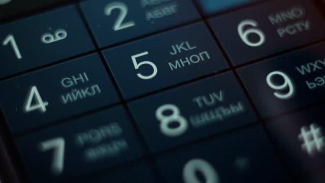 nahaufnahme die telefonnummer auf smartphone, radiophone und cellphone - zahlentastatur stock-videos und b-roll-filmmaterial