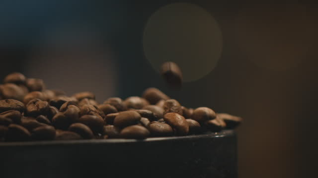Close-up dolly shot of roasted coffee beans