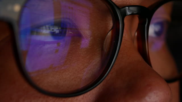 Close-up Eye of Businessman looking on Computer screen with Glasses