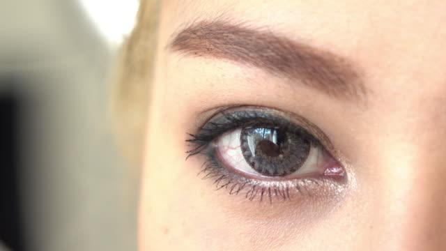 close-up eye woman makeup beauty 4k, close-up eye woman makeup beauty looking at camera mascara stock videos & royalty-free footage