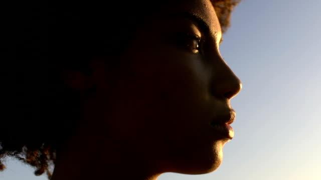Close-up face of beautiful sad woman enjoying sunset, purity and sincerity
