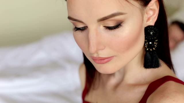 Close-up face of woman with blue eyes in bed. video