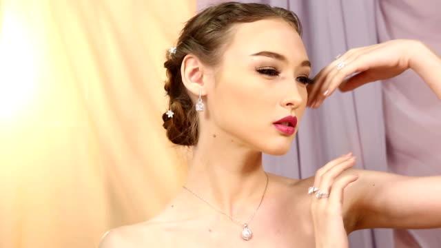 close-up fashion portrait of Diamond ring, necklace, bracelet, earrings sensual Caucasian Lady video