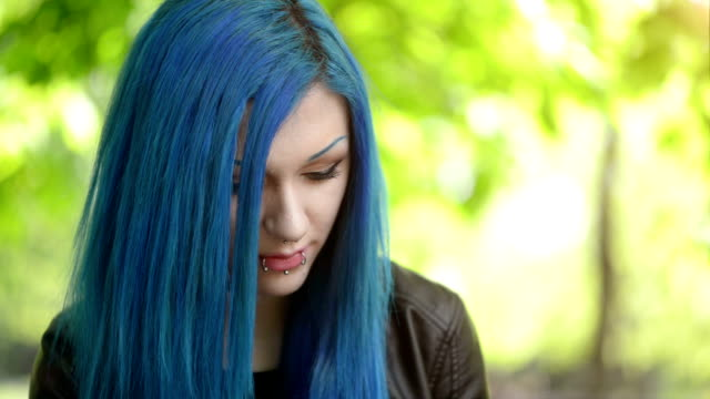 close-up female face Portrait of a cute young female with blue hair blue hair stock videos & royalty-free footage