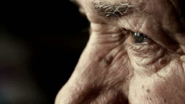 closeup footage on very old man's eyes: thoughtful elderly man video