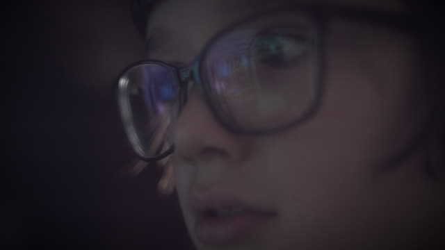 4K Close-up Game Reflection in Glasses of a Child Eyes video