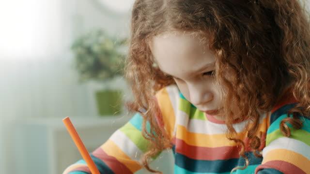 close-up, girl doing homework. - kids drawing стоковые видео и кадры b-roll