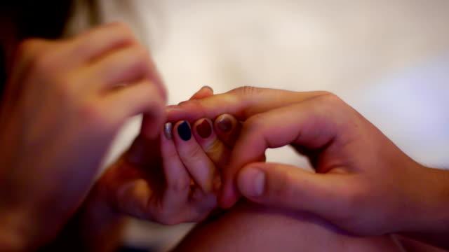 closeup girl hands make manicure for her boy friend - ludzki palec filmów i materiałów b-roll