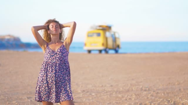 Closeup girl on the background rv camping against the sea