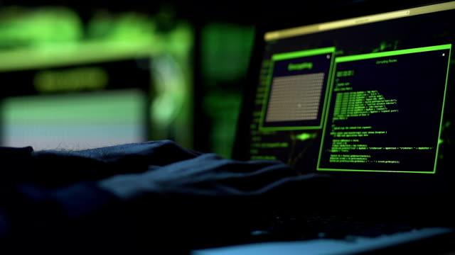 vídeos de stock, filmes e b-roll de hacker de close-up mãos trabalhando no laptop, selecionando a senha, acesso concedido - acessibilidade