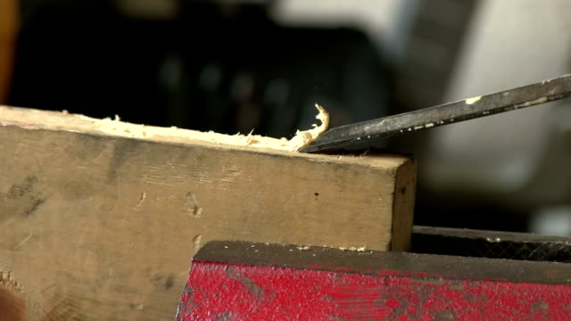 closeup hammering wood chisel in red vice with sound video