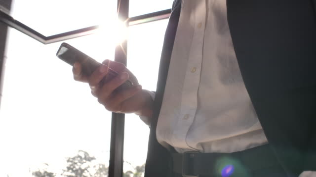 Close-up hand Businessman texting on cell phone Close-up hand Businessman texting on cell phone business suit stock videos & royalty-free footage