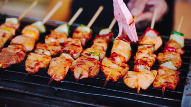 closeup hand man or pinging grill chef, barbeques on the stove. - spiedino video stock e b–roll