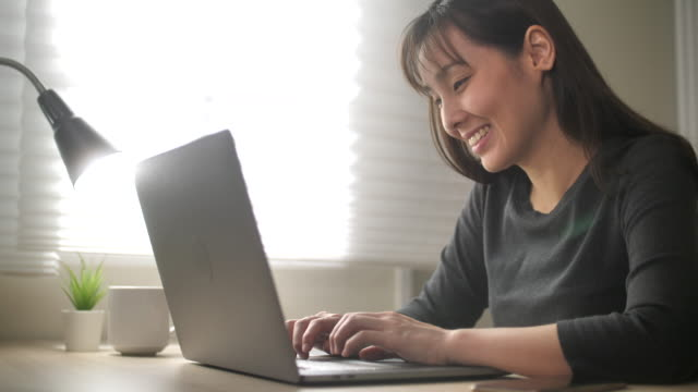 Close-up Hand of Asian Woman using Laptop at home, Close-up of Technology in use