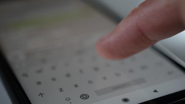 Closeup hands of a man using smartphone video