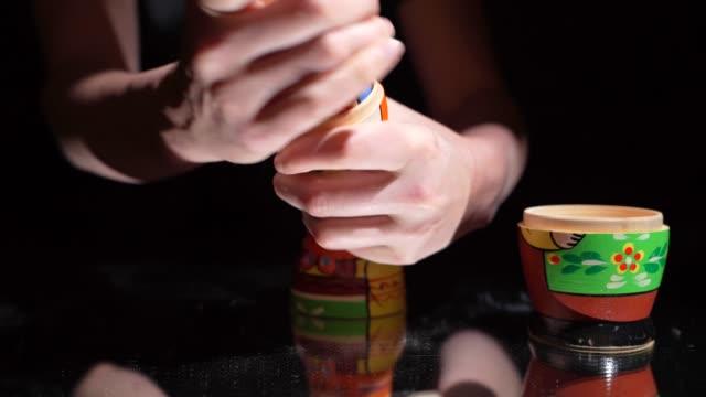 closeup hands opening Russian dolls video