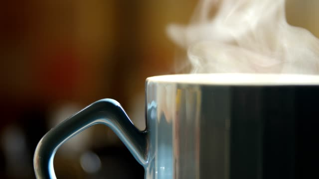 Close-up hot cup with steam Close-up hot coffee with steam mug stock videos & royalty-free footage