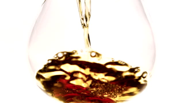 Close-up in glass goblet is poured brown liquid video