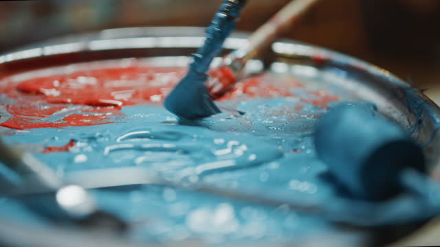 Close-up Industrial Artist Mixes Paints with a Paint Brush in the Palette. Renovation Work in Progress, Choosing of Colors Close-up Industrial Artist Mixes Paints with a Paint Brush in the Palette. Renovation Work in Progress, Choosing of Colors expressionism stock videos & royalty-free footage