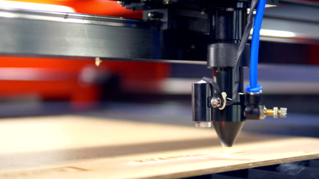 Close-up. Industrial robotic laser cutter parts with great precision video