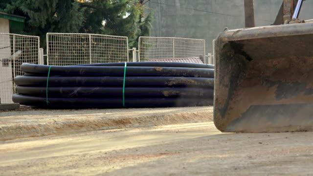 Closeup loader excavator at road construction work video