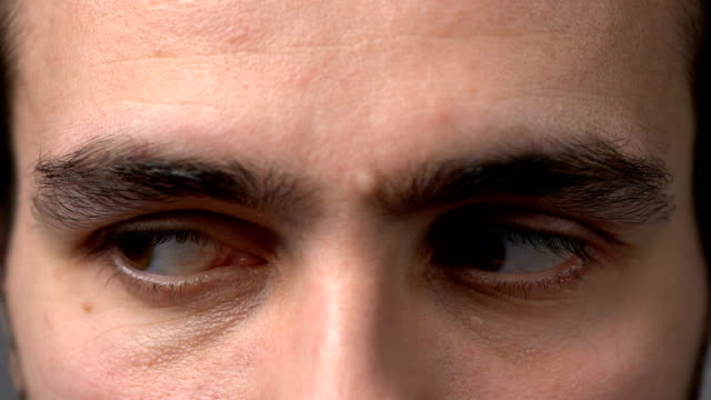 close-up man eyes looking - due oggetti video stock e b–roll
