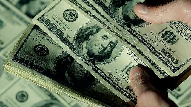 Closeup Man is Counting His Money.100$ Banknotes. video
