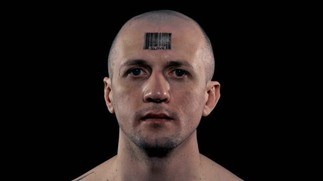 close-up man who has a barcode on his forehead with a inscription slave close-up man who has a barcode on his forehead with a inscription slave, opens his eyes and looks into the camera obedience stock videos & royalty-free footage