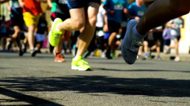 closeup marathon runners legs - race stock videos & royalty-free footage
