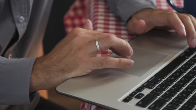 closeup married guy using pc. - key ring stock videos & royalty-free footage