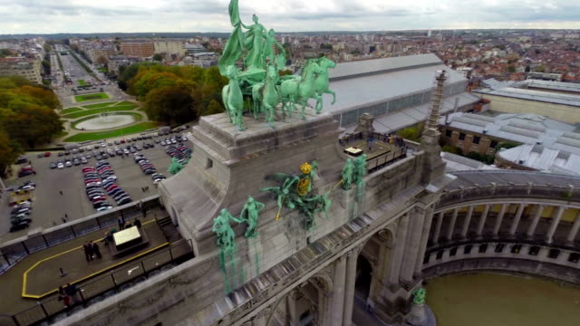 Close-up monument European architecture aerial shot Brussels. Beautiful aerial shot above Europe, culture and landscapes, camera pan dolly in the air. Drone flying above European land. Traveling sightseeing, tourist views of Belgium. video