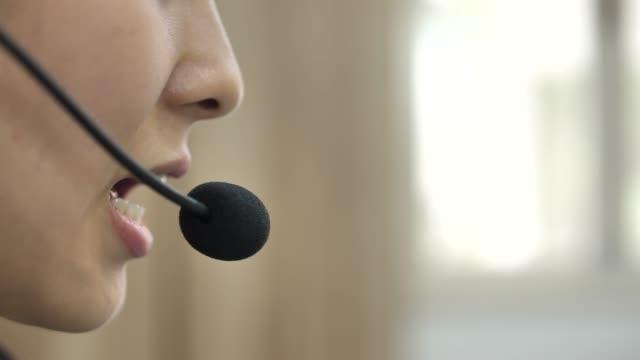 close-up mouth of call center worker with headset - cuffia attrezzatura per l'informazione video stock e b–roll