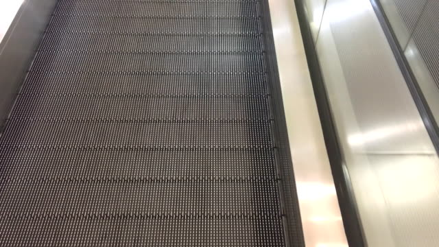 Close-up movement of the escalator in the mall.