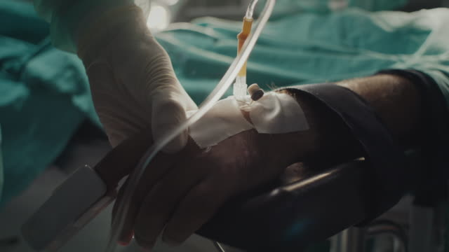 Close-up, nurse putting oximeter on patient's hand video