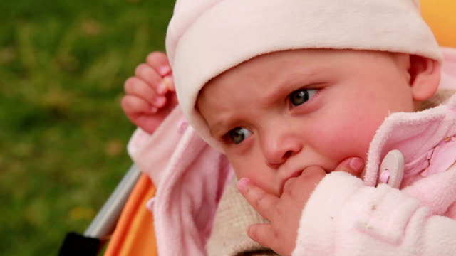 Close-up of a baby falling asleep in the pram video